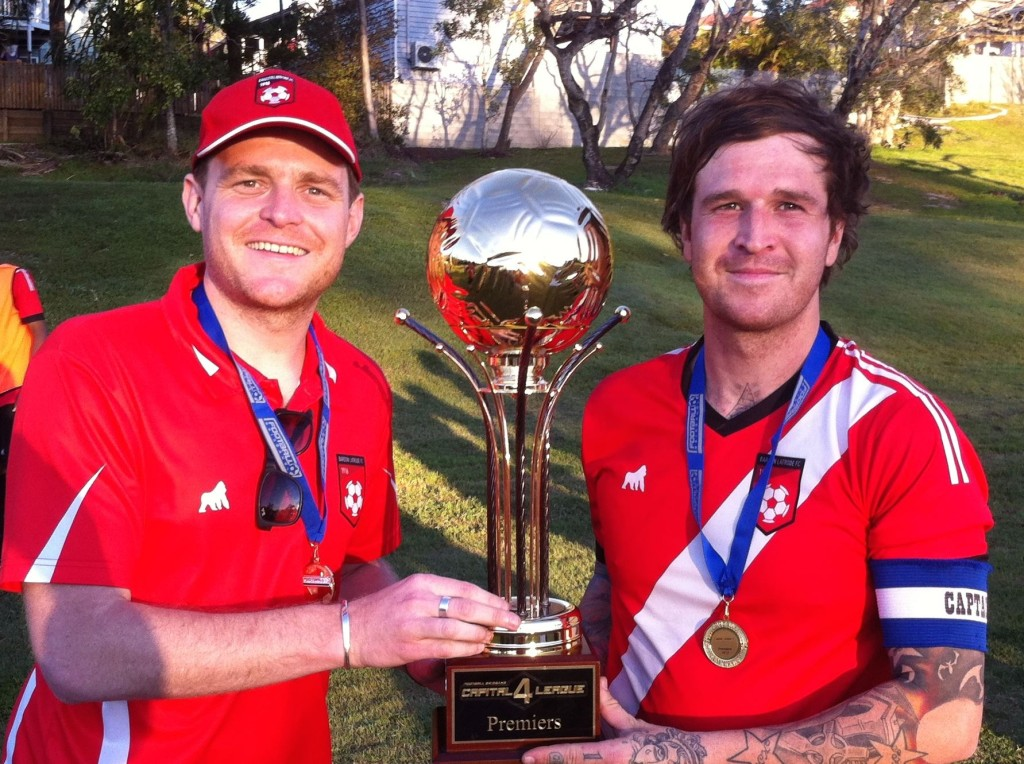 Senior Head Coach David Bounds with Club Captain Adam Hope collecting the minor premiership (Capital Four) trophy.